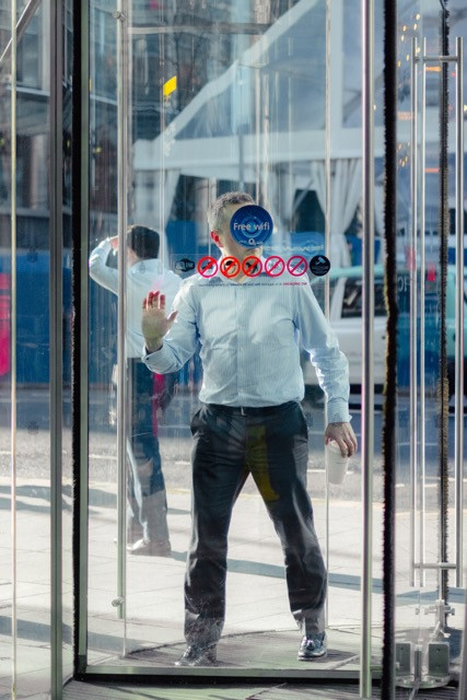 Man in revolving door