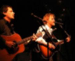 Austin, Texas musicians Bob Livingston and Tucker Livingston play at the International Folk Alliance.