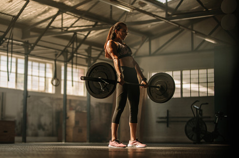 Female deadlifting.
