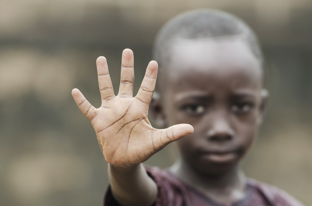 """African boy says """"Stop It"""" to racism"""