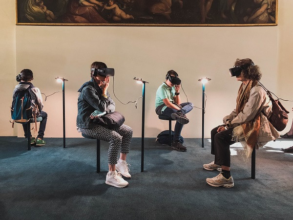 A number of people using virtual reality headsets