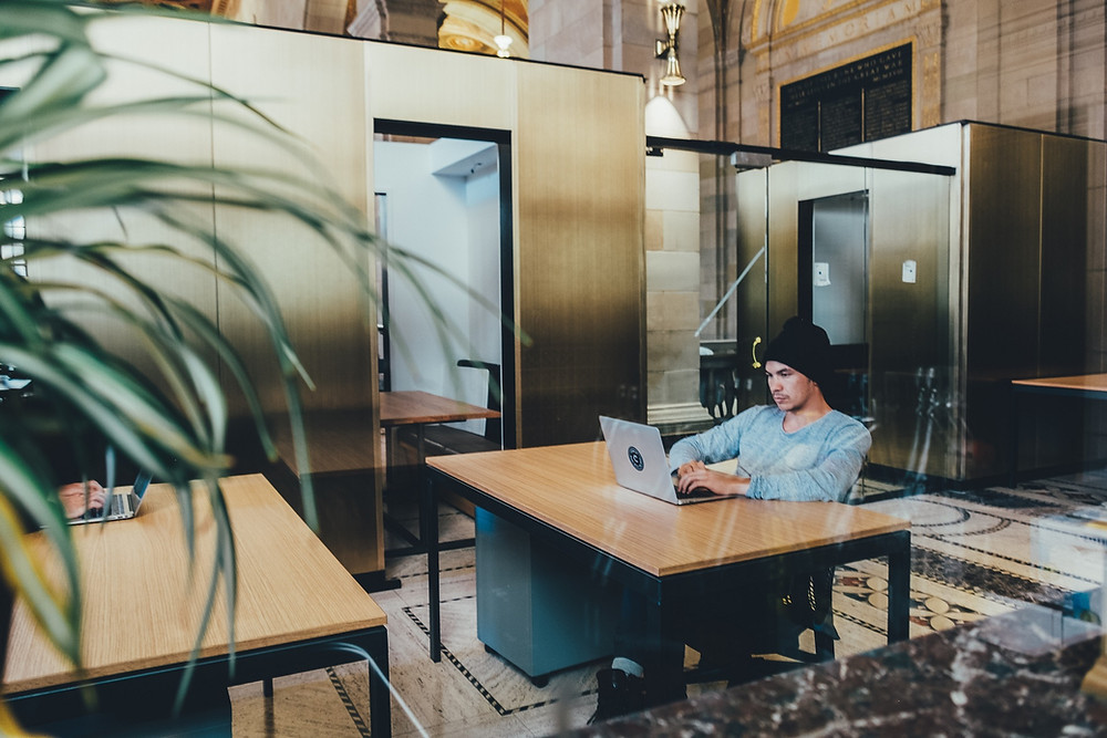 A man working in the lobby of a building