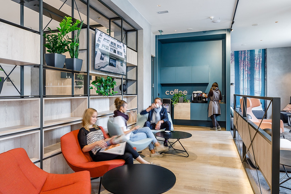 This lobby designed and built by CAPEXUS features shared and separate areas for work, respite and socializing