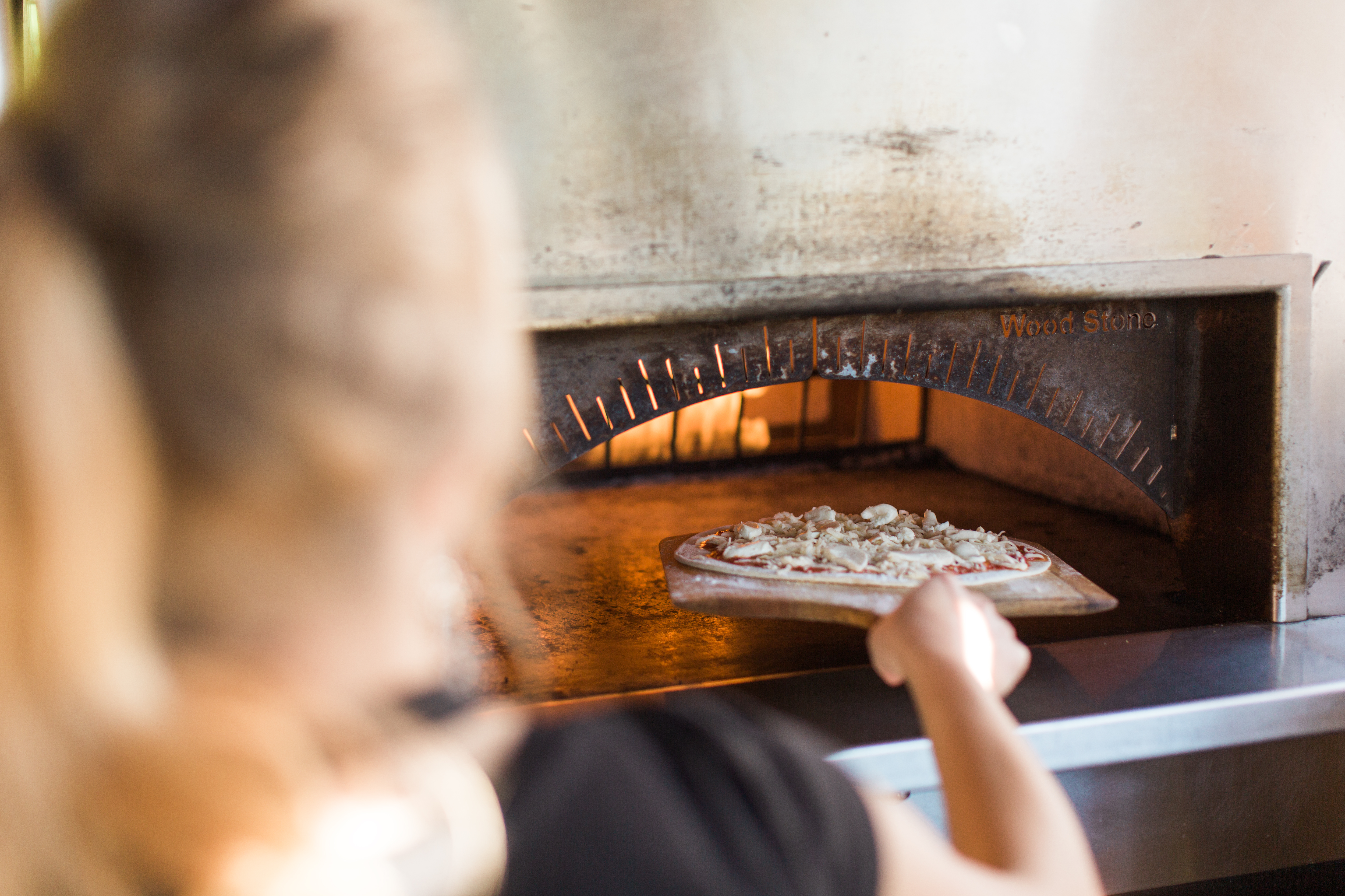 Wood fire pizza oven at CHAOS Bistro