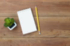 note-book-with-pencil-office-wooden-tabl