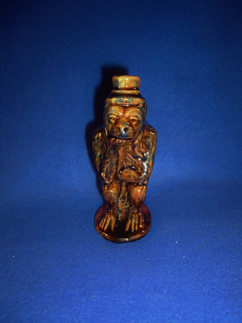 Yellow Ware Seated Monkey Figural Flask in Multi-Colored Glaze