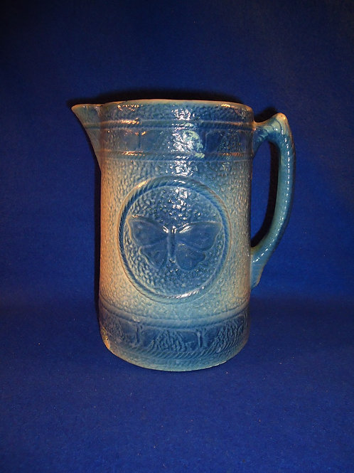 Blue and White Stoneware Pitcher in the Butterfly Pattern