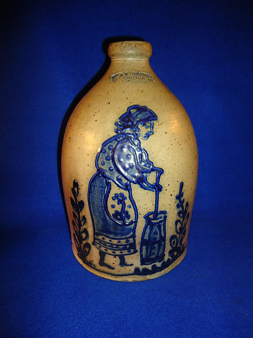 R. & B. Diebboll, Washington, Michigan Stoneware Jug with Woman Churning Butter