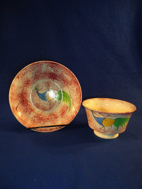 Staffordshire Red Spatterware Cup and Saucer with Peafowl Decoration