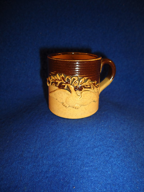 Miniature Yellow Ware Mug with Applied Eagle and Man Smoking