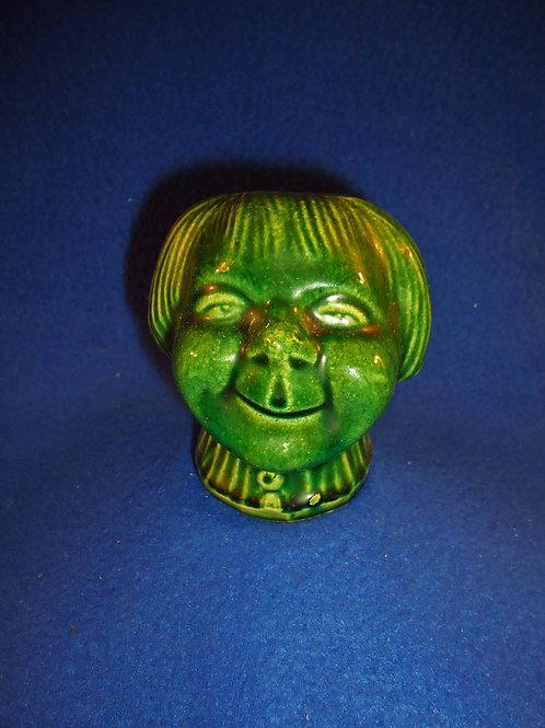 Circa 1900 Stoneware Bank, Young Girl, Green Glaze  #4427
