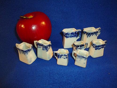 Circa 1900 Set of 8 Graduated Miniature Blue and White Spongeware Pitcher