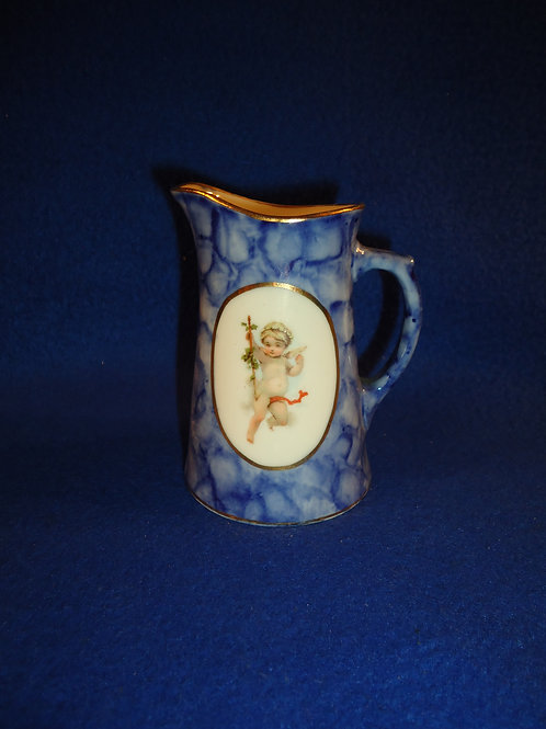 Circa 1900 Small Blue and White Pitcher with Cherub