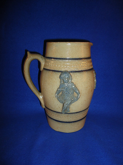 Whites of Utica, New York Stoneware Pitcher with Applied Decoration. #4547