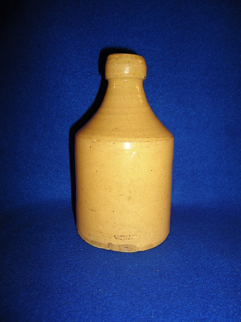 "Yellow Ware Bottle made by ""Bennett & Brothers, Liverpool, Ohio"""