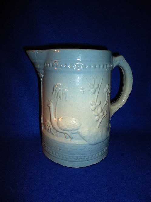 Blue and White Stoneware Pitcher in the Peacock Pattern