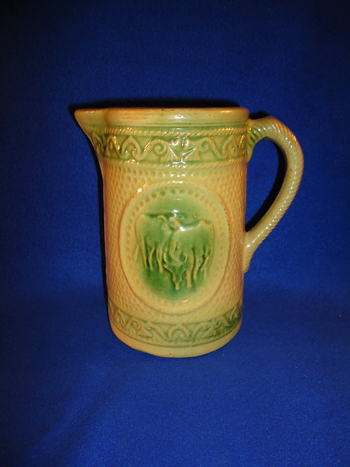 "Yellow Ware Green and Cream 7 3/8"" Grazing Cow Pitcher by A. E. Hull"