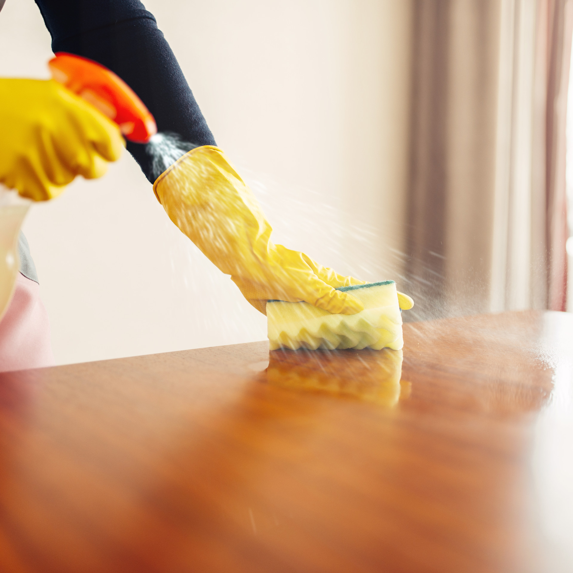 housemaid-hands-cleans-table-with-cleani