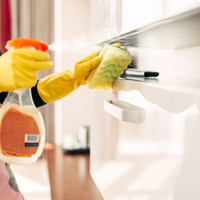 housemaid-cleans-furniture-with-a-cleani