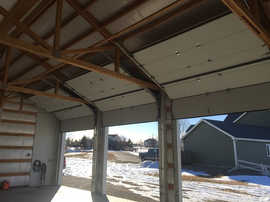 3 Garage doors with roofpich installation