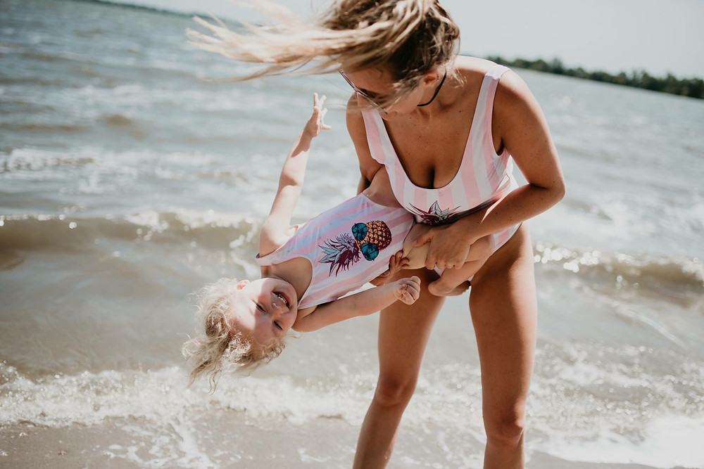 Mum and daughter on a beach