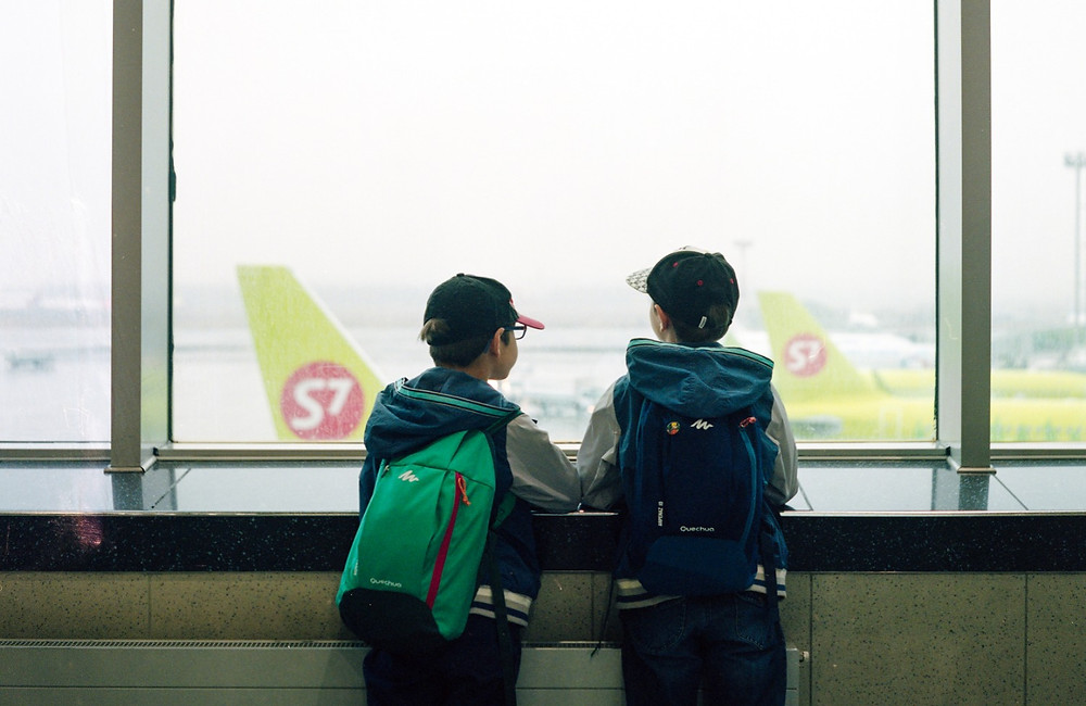 Kids at an aiport