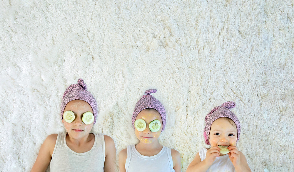Children with face masks on relaxing