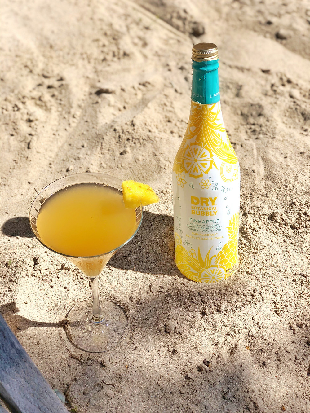The Tropical Mom-osa by DRY Botanical Bubbly. Non-alcoholic mimosa recipe with Pineapple soda.