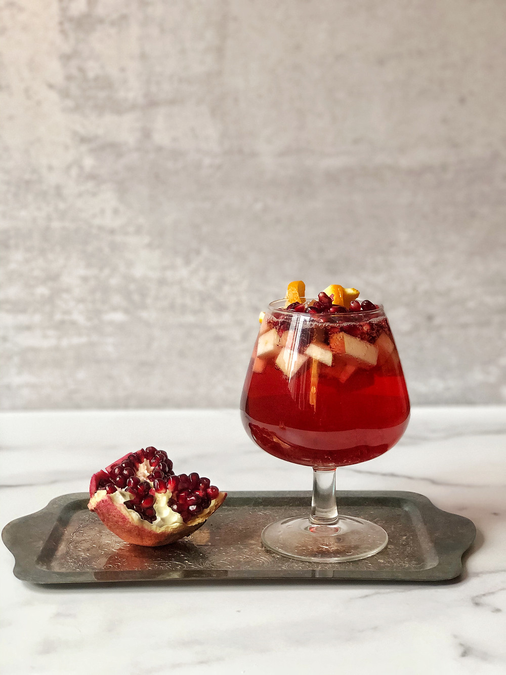 The Sanderson Sister Sangria is a beautiful, bright red, fall themed non-alcoholic sangria for all of your Halloween movie watching refreshment.