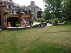 Perfectly Cut Lawn with Patio and Gardening Features