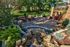 Flowing Water Fall With Paver Patio
