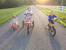 Addy Riding with Siblings.jpg
