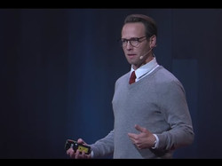 Joe presenting at TEDxUSU