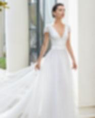Robe de mariée élégante en plumetis créée par Ros Clara