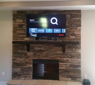 Crestview, FL TV Mounted above stone fireplace
