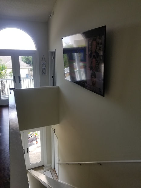 """80"""" TV Mounted in second story stairwell"""