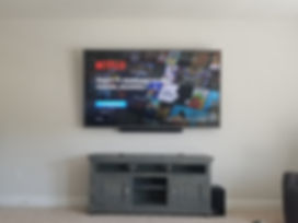 "86"" TV Mounted with attached soundbar Miramar Beach, FL"