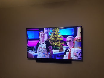 TV mounted with attached soundbar Navarre, FL