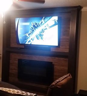 65 Inch TV mounted with Sonos Soundbar mounted underneath