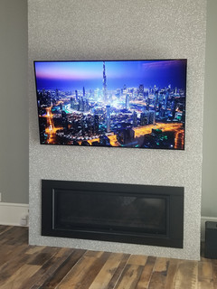 """77"""" OLED on stainless stubbed wall destin fl"""