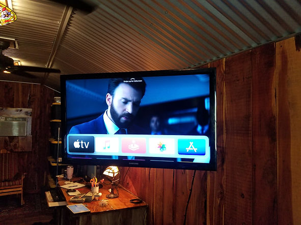 Office TV mounted to wooden wall Defuniak Springs