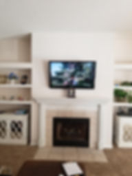 Crestview TV above fireplace