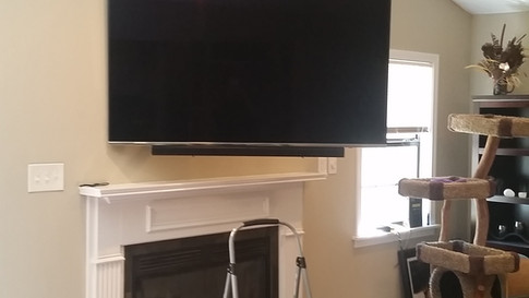 Articulating Wall Mounted TV with soundbar attached Milton, FL