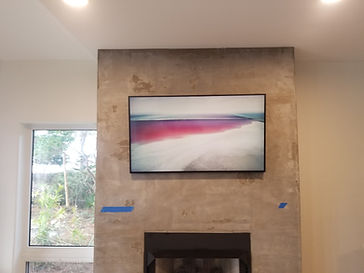 """55"""" Samsung Frame mounted over fireplace Bluewater, FL"""