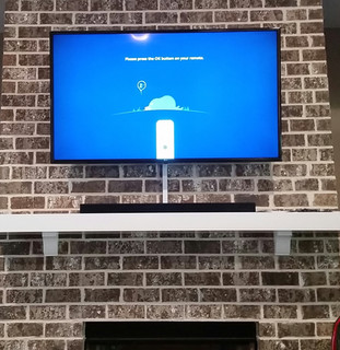 Niceville TV  mounted brick fireplace