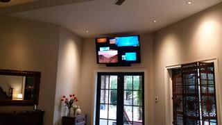 Santa Rosa Beach TV mounted above doors