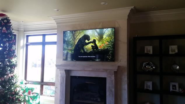 Miramar Beach, FL. Granite mounted TV above fireplace