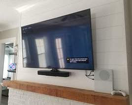 65 mounted with soundbar attached above fireplace, Destin, FL