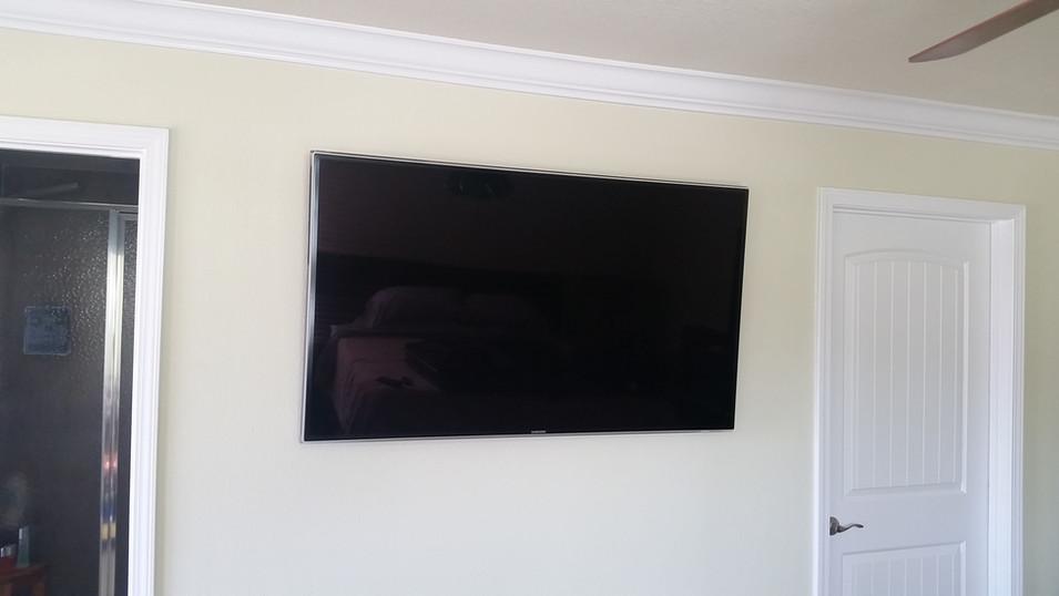 Santa Rosa Beach FL -TV Wall mounted with PS4 and DirecTV mounted behind TV