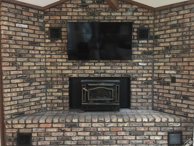 Fort Walton Beach TV on Brick Fireplace